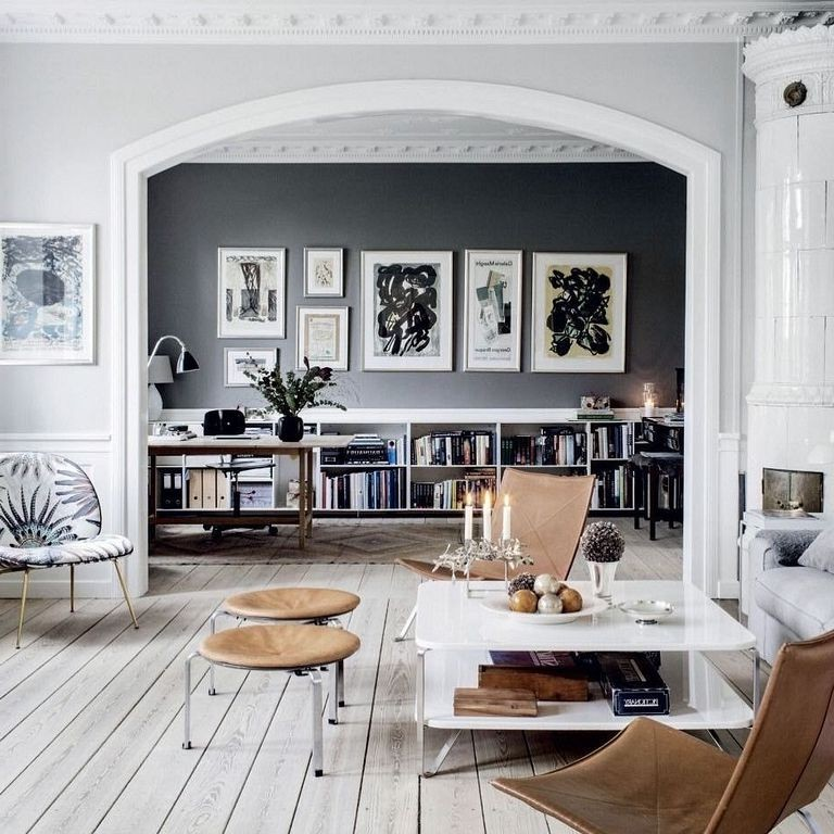 Note how great this almost black wall looks in this home office. With the framed artwork and white shelves below this room becomes an interesting backdrop. Source: futurehouz.com