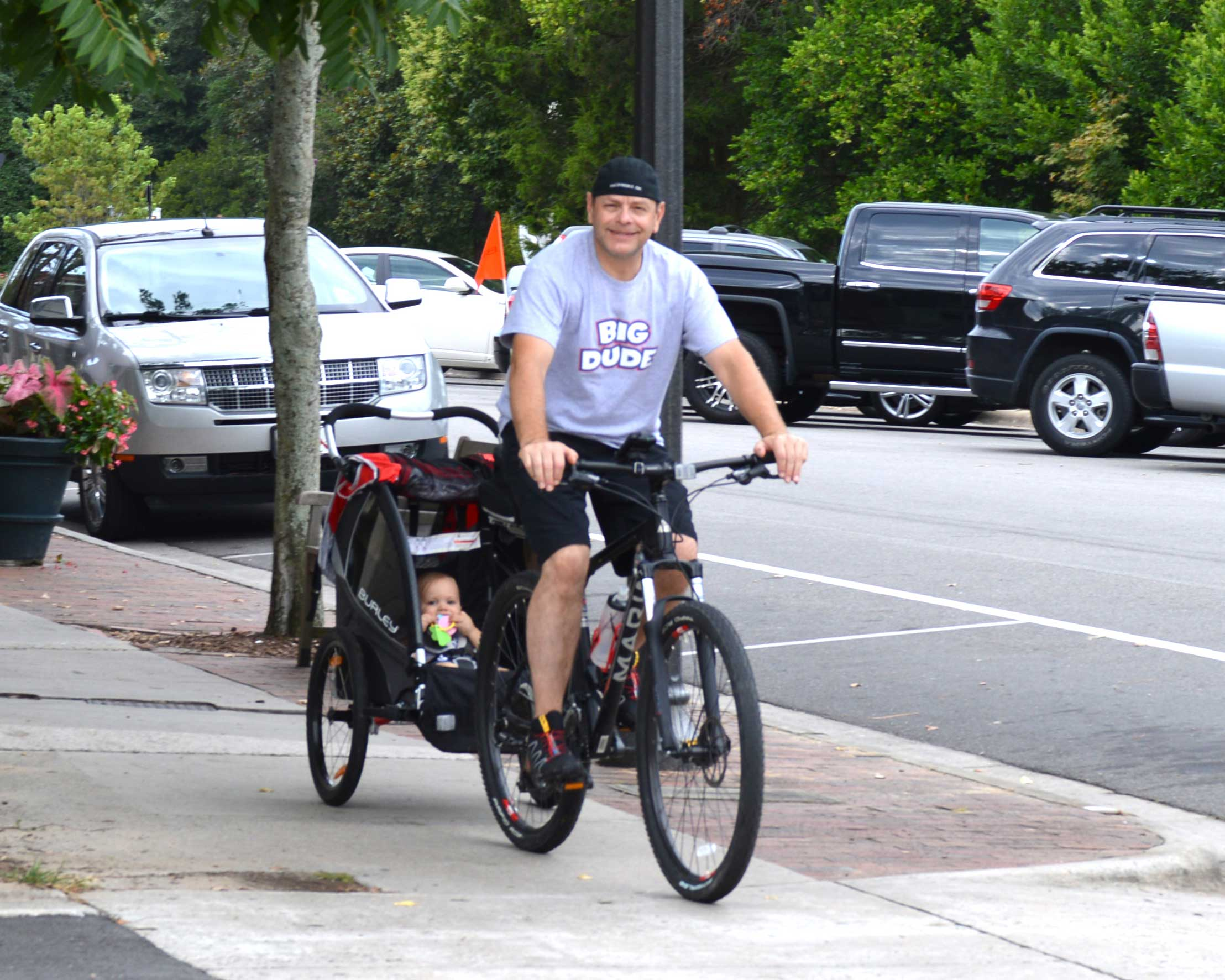 Sean and Benjamin biking to the Farmers Market