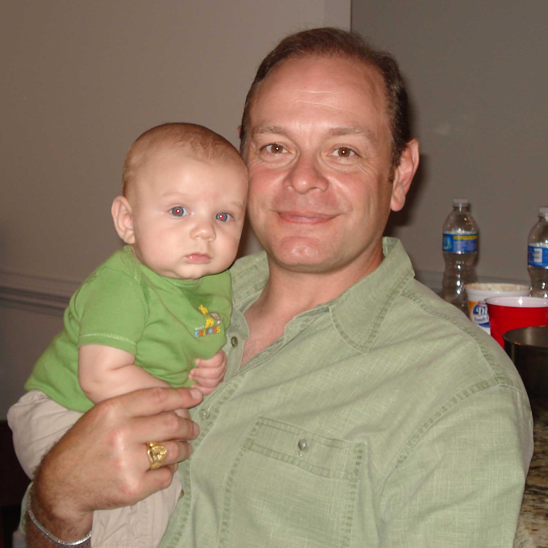 Sean holding our friend's son