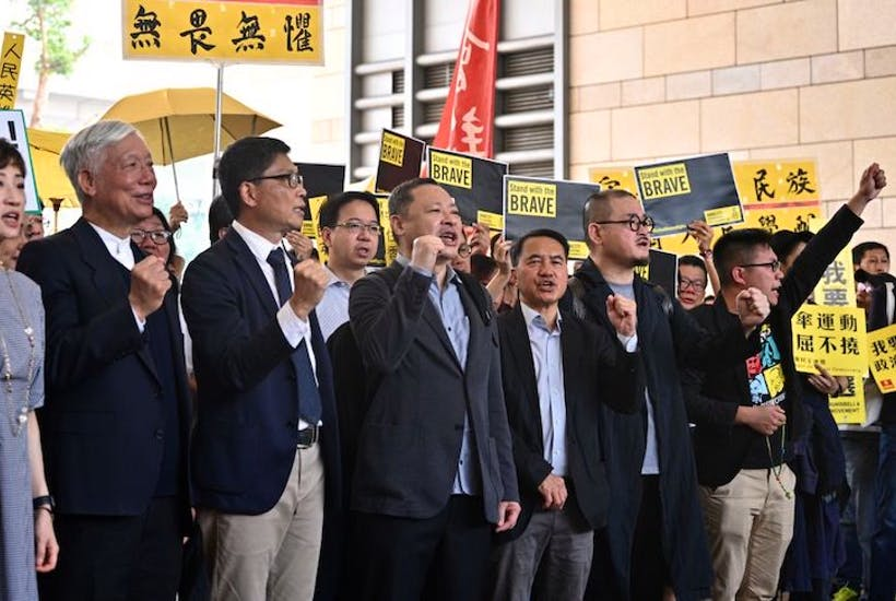 The Umbrella Movement leaders outside West Kowloon Magistrates Court in Hong Kong.