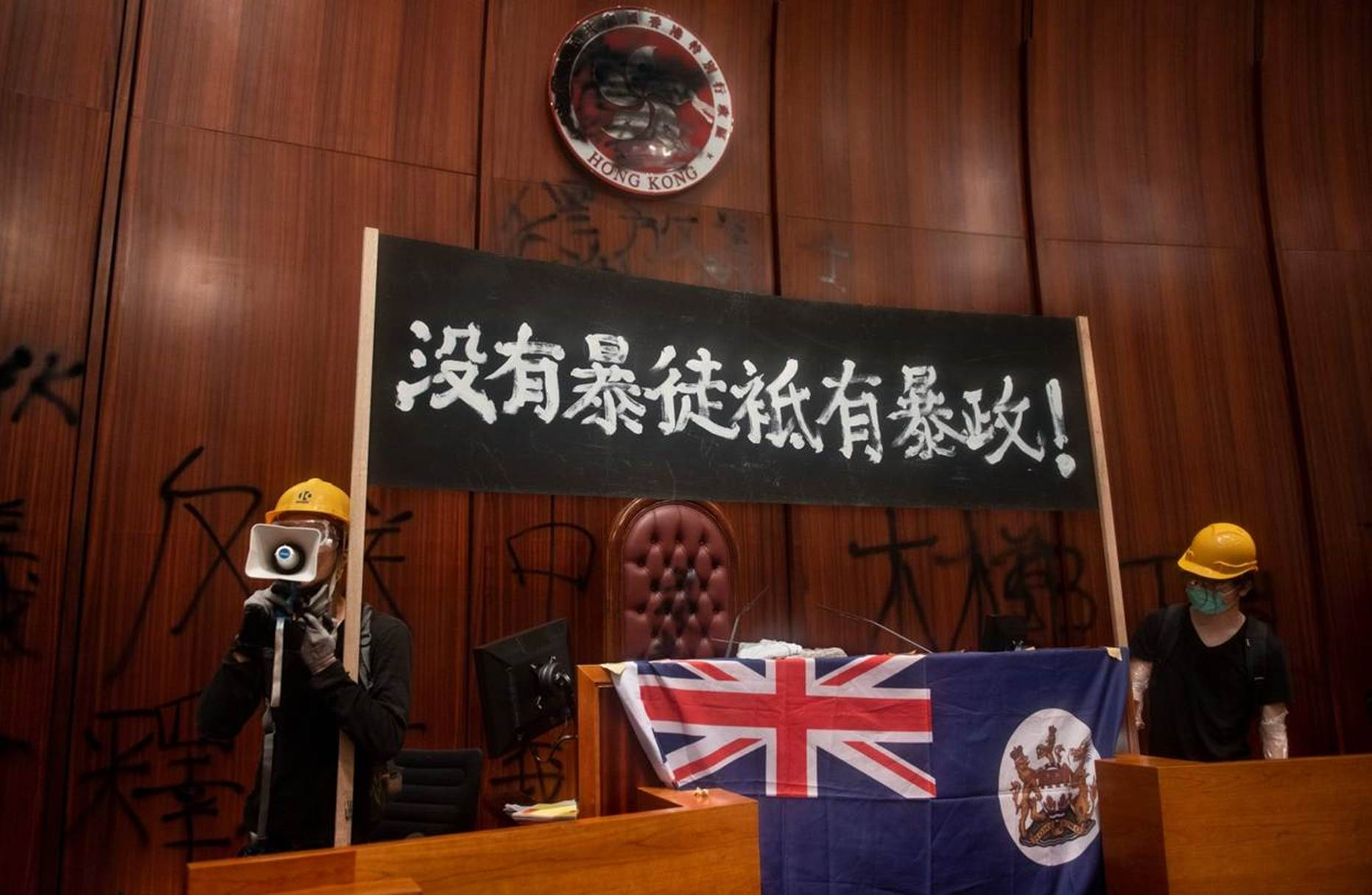 Protesters in the Legislative Council building in Hong Kong, July 1. PHOTO: SOPA IMAGES/LIGHTROCKET VIA GETTY IMAGES
