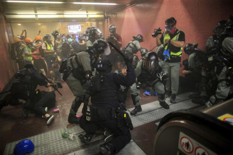 Policemen charge and arrest protesters inside the Tai Koo MTR station during the anti-extradition bill protest in Hong Kong, on Aug 11, 2019. PHOTO: AP