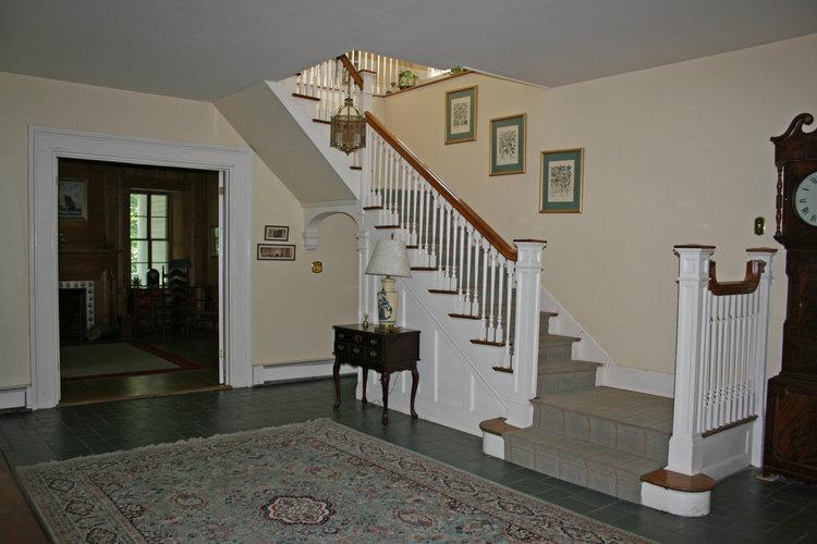 3d)Foyer-Stairs-Den+copy.jpg