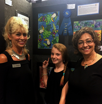 "2015 Art-tini 1st place winner Cassidy Hughes for her mixed media artwork titled ""American Rainforest Jazzy Jingle""."