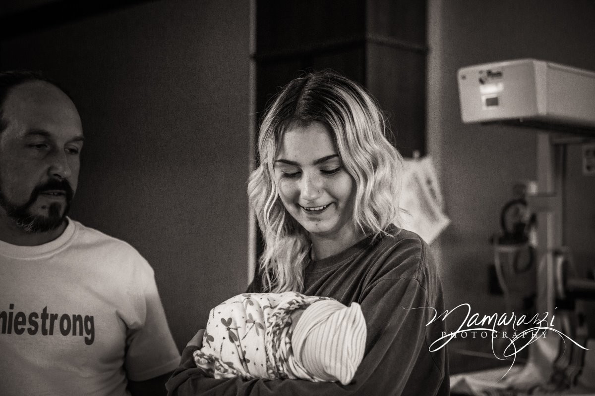 www.jhmamarazziphotography.com  There's a bit of an age gap, but this big sister was excited to hold her baby sister for the first time.