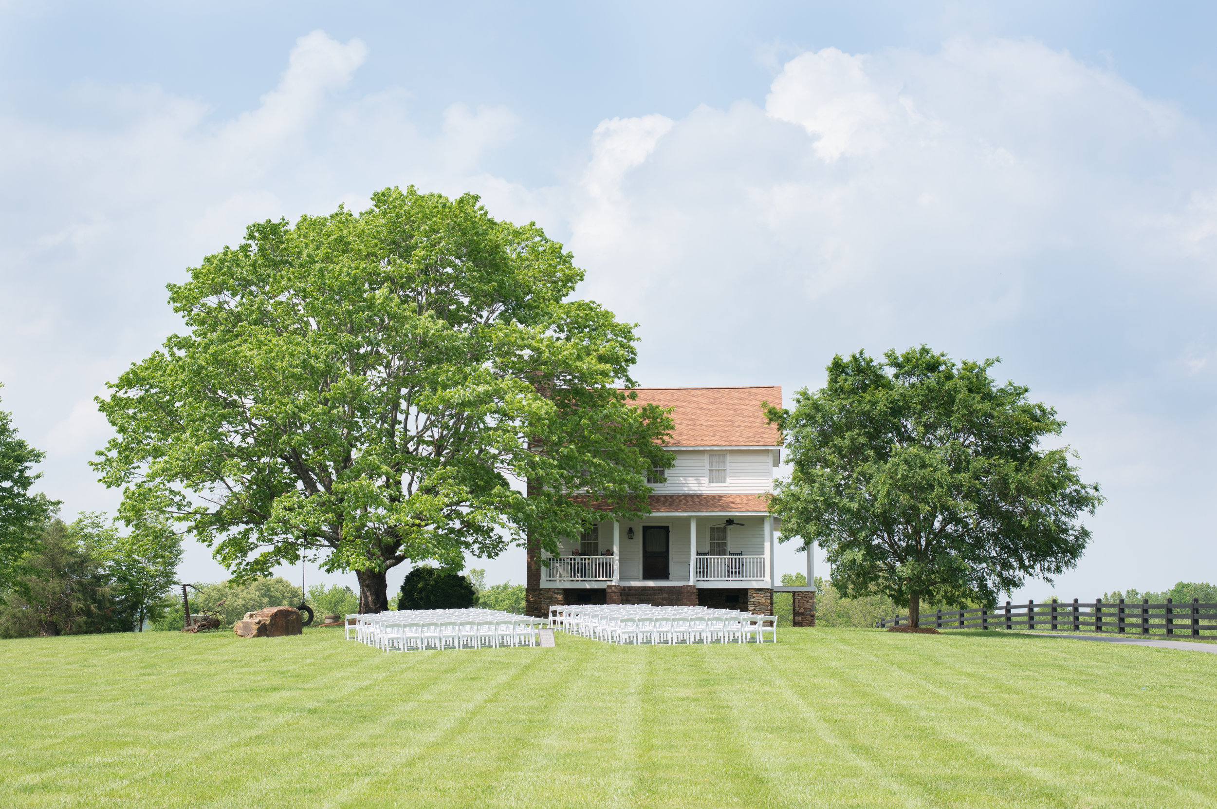 Courtney has a personal connection with this property, so getting married under the tree with the tire swing was a very personal touch and such a charming country setting for a wedding.