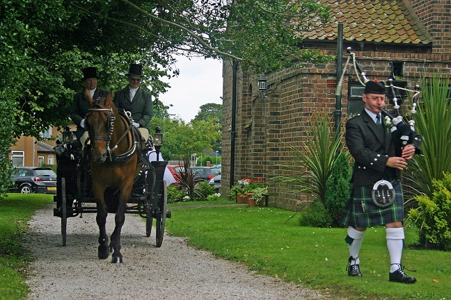 Bagpiper in Wales Sian Horse Carriage.jpg