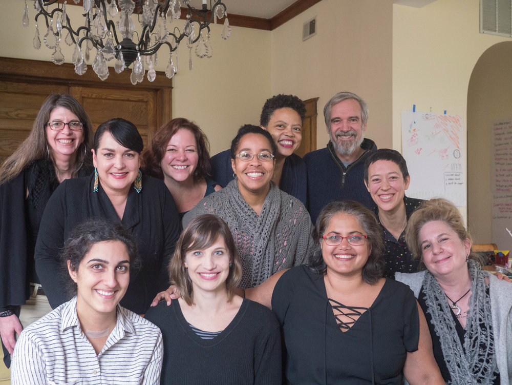 """A great group photo of the MAG, team with """"Influencing Complex Systems Change"""" authors Natasha Winegar and Susan Misra front and center, and the real Elissa Perry popping up in the back."""