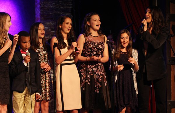 Idina Menzel with students of NewArts at FYL Fundraiser