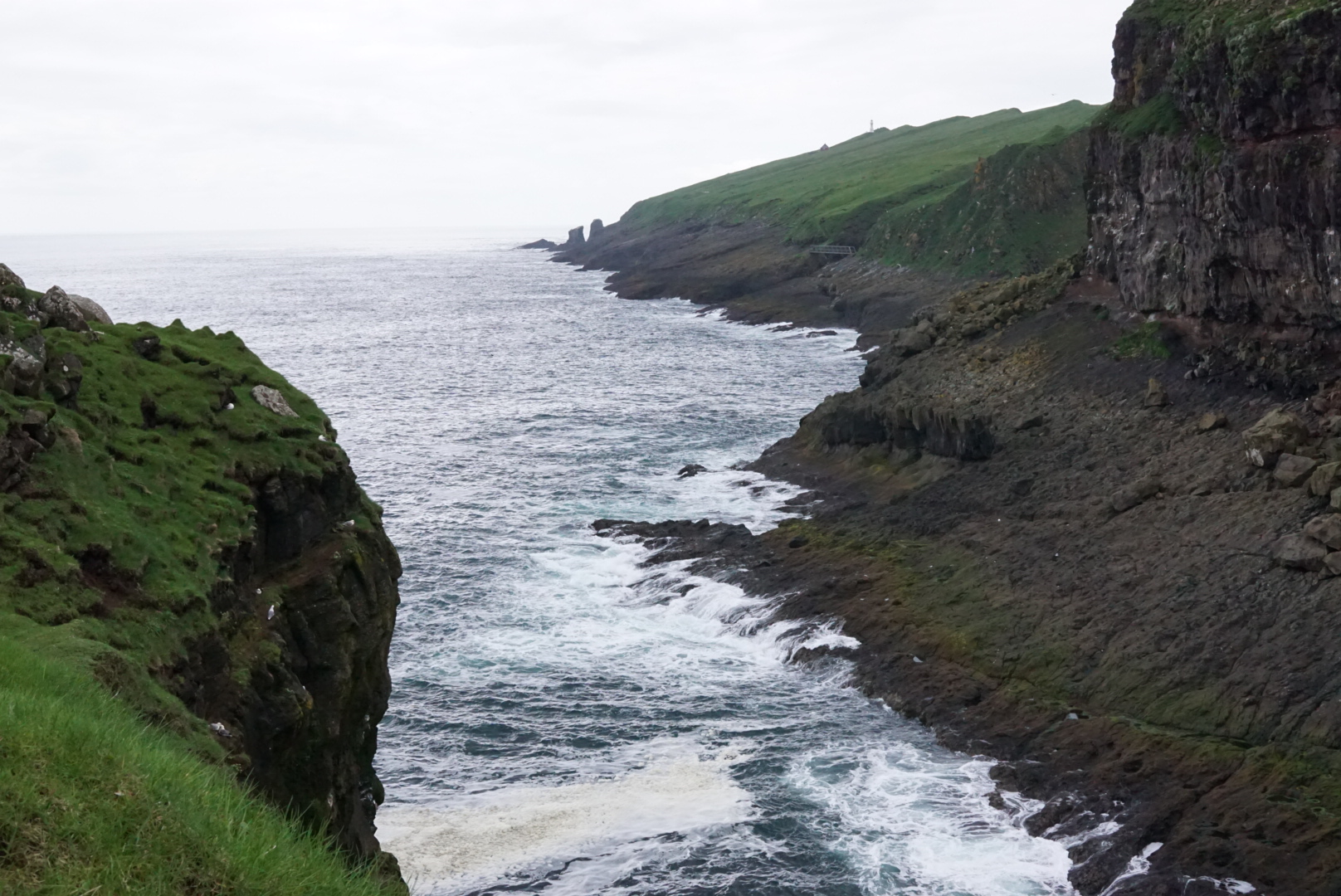 View of the ocean west of Mykines from the island just above the harbor.