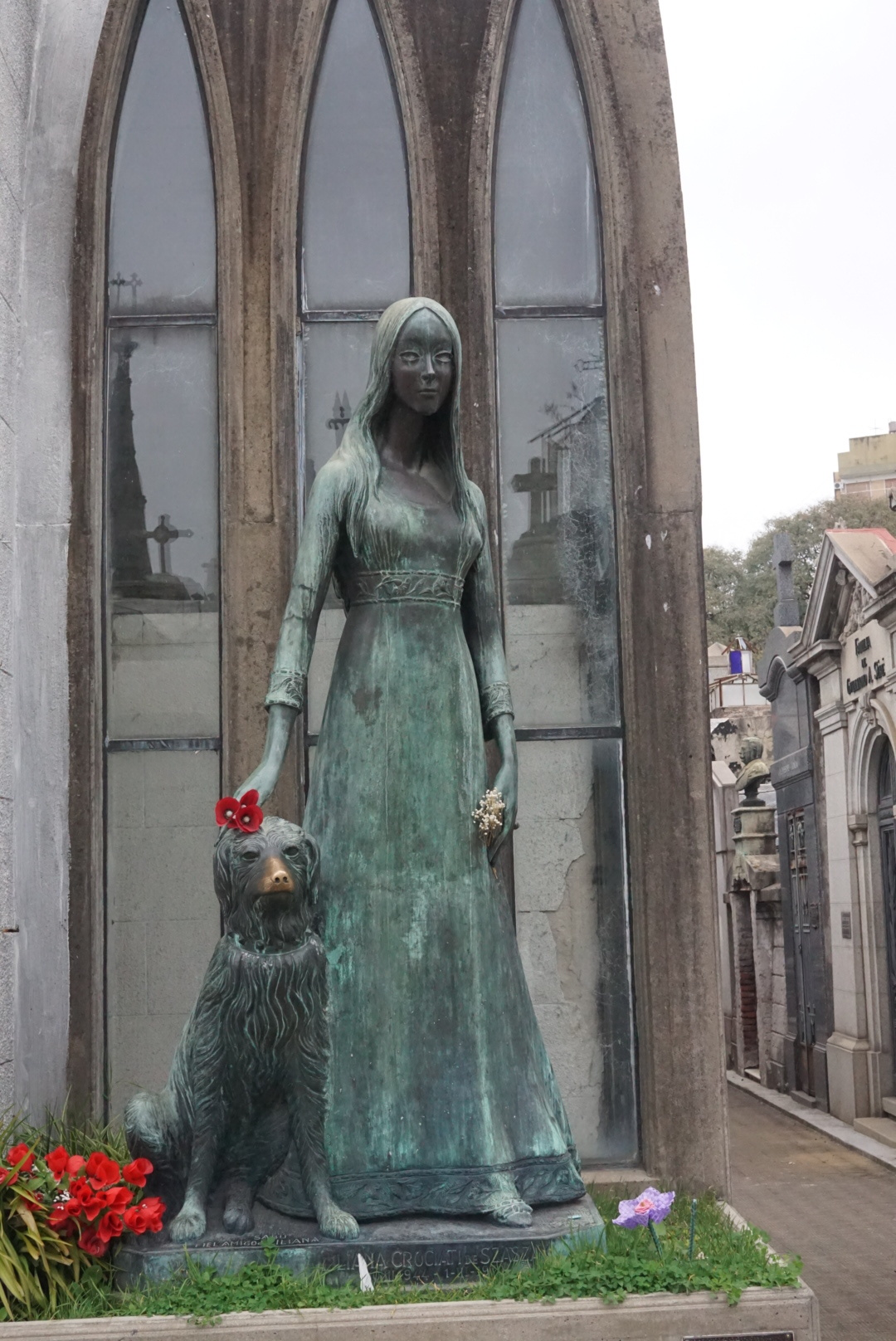 Pretty statue at the memorial of a very young person who died, in Recoleta.