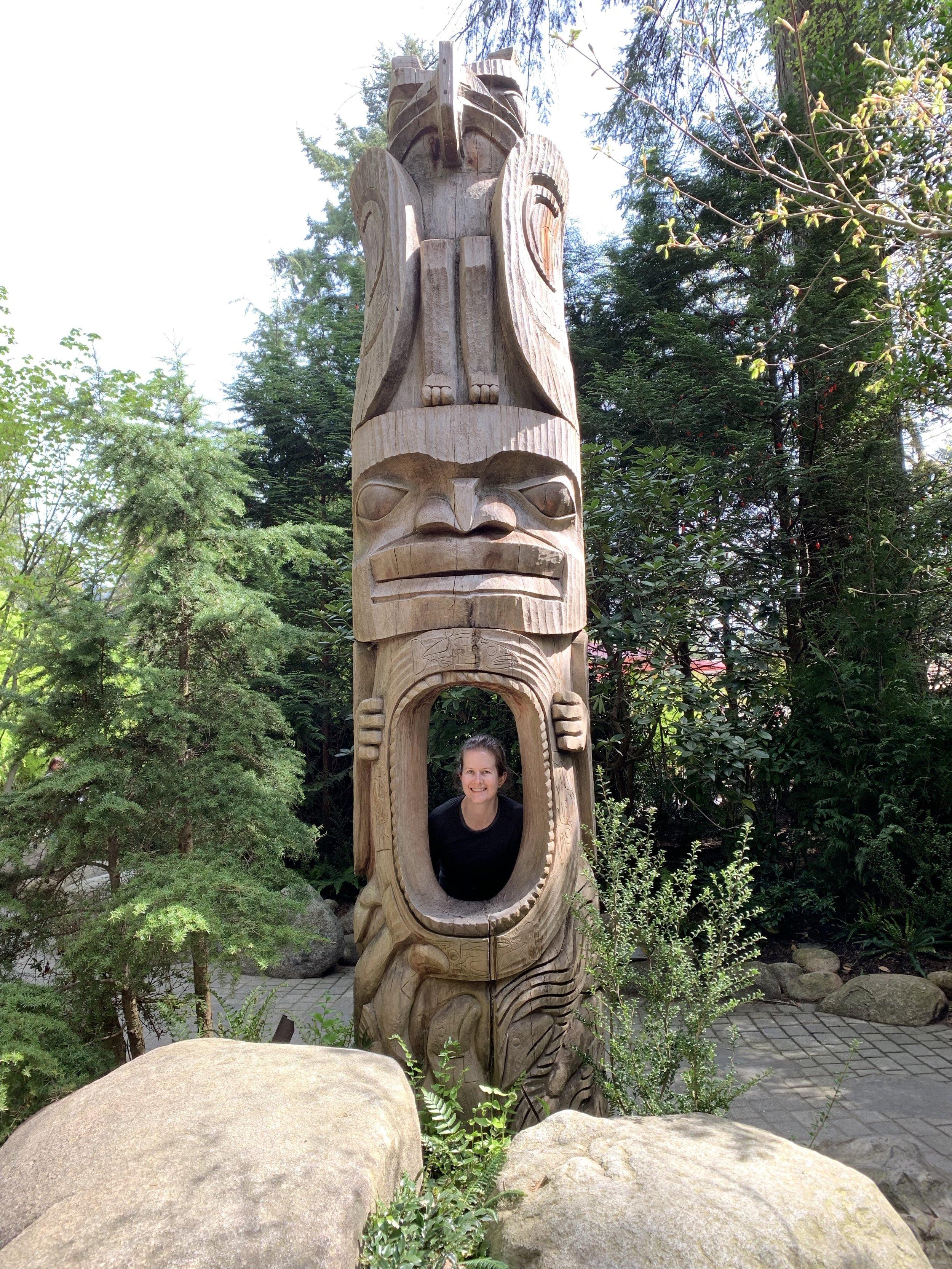 Posing in the totem poles.