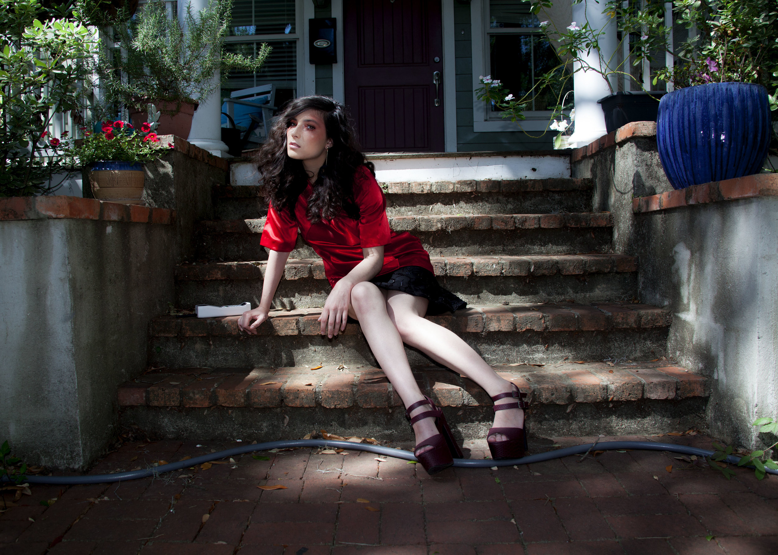 Modeled by Paulina Ramirez, MUA: Art by Evonics, dress: JD Noble, Photo by Ann Van Epps