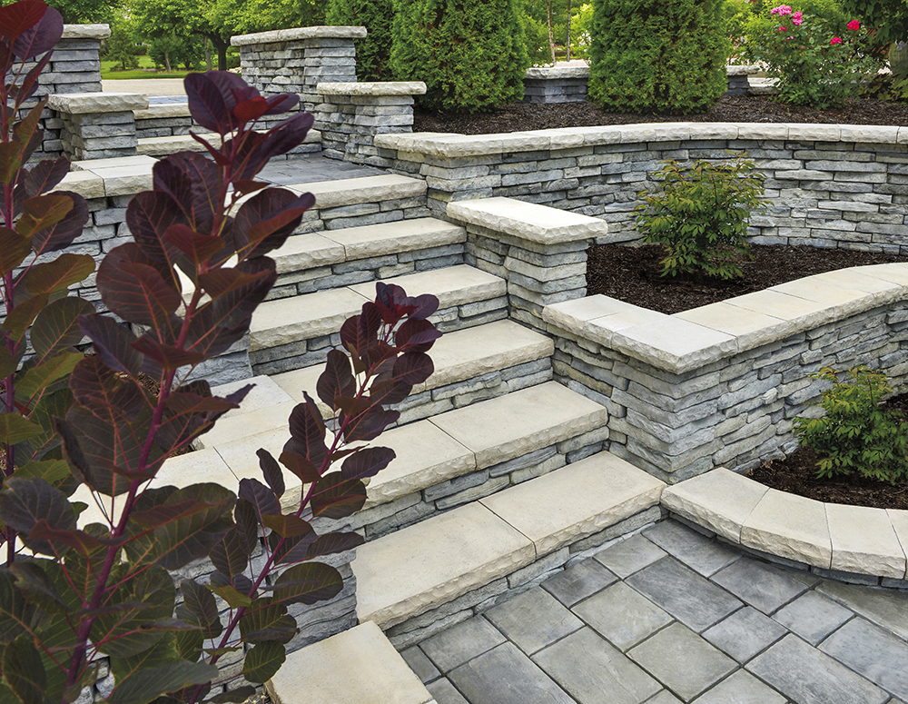 RICHCLIFF PAVER IN DAWN MIST AND RIVERCREST WALL IN COASTAL SLATE WITH LEDGESTONE COPING IN BUFF