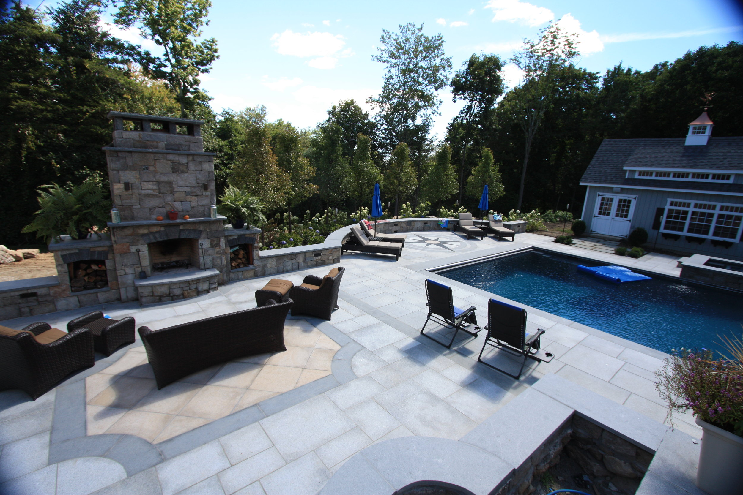 MATERIALS USED: NEWPORT DARK GRANITE PATIO WITH FALMOUTH BUFF GRANITE CENTER ACCENT. CT FIELDSTONE, SQUARE CUT FIREPLACE PHOTO CREDIT: MIMMO CARATOZZOLO