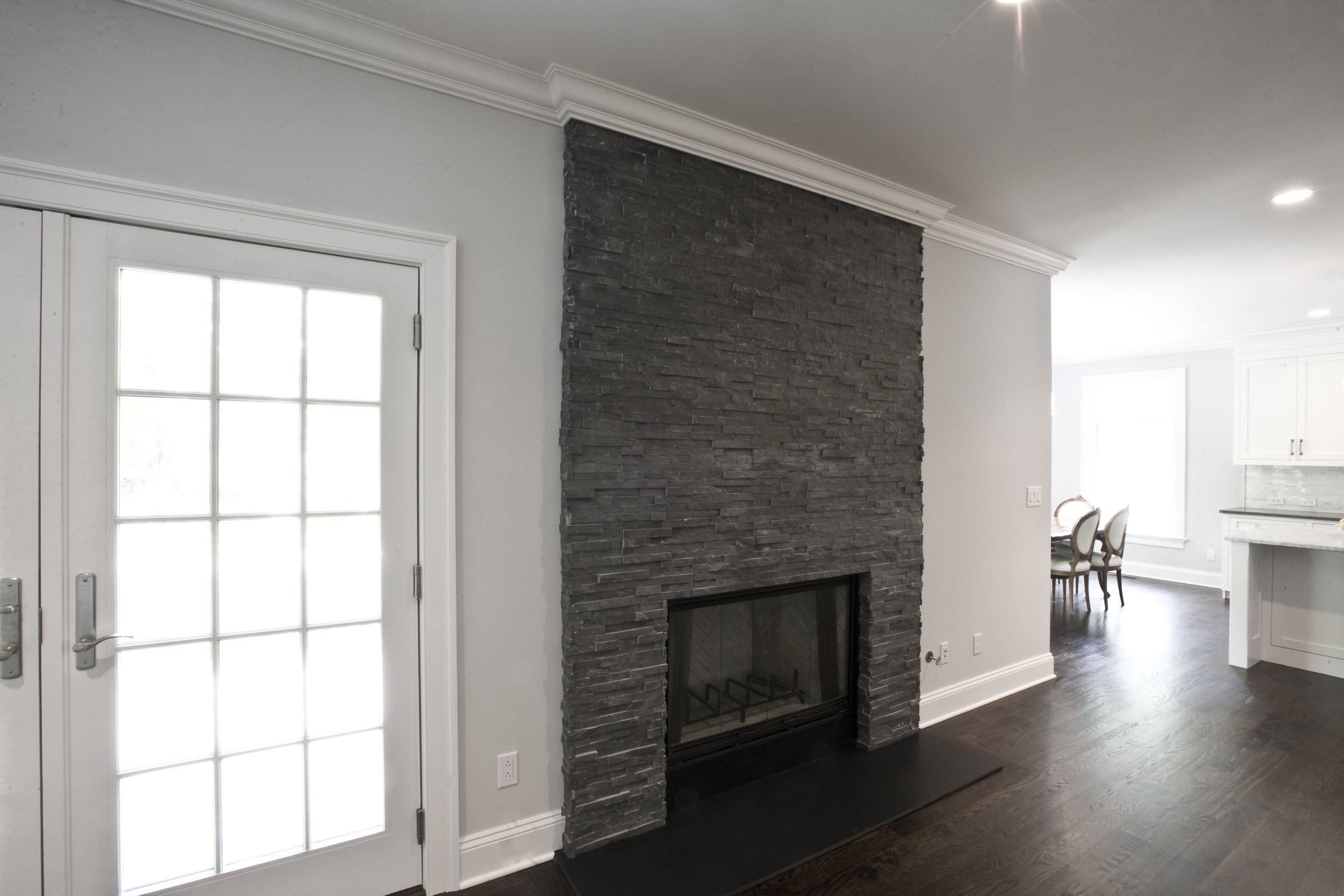 MATERIALS USED: CHARCOAL SHADOWSTONE BY REALSTONE WITH POLISHED BLACK ABSOLUTE GRANITE HEARTH