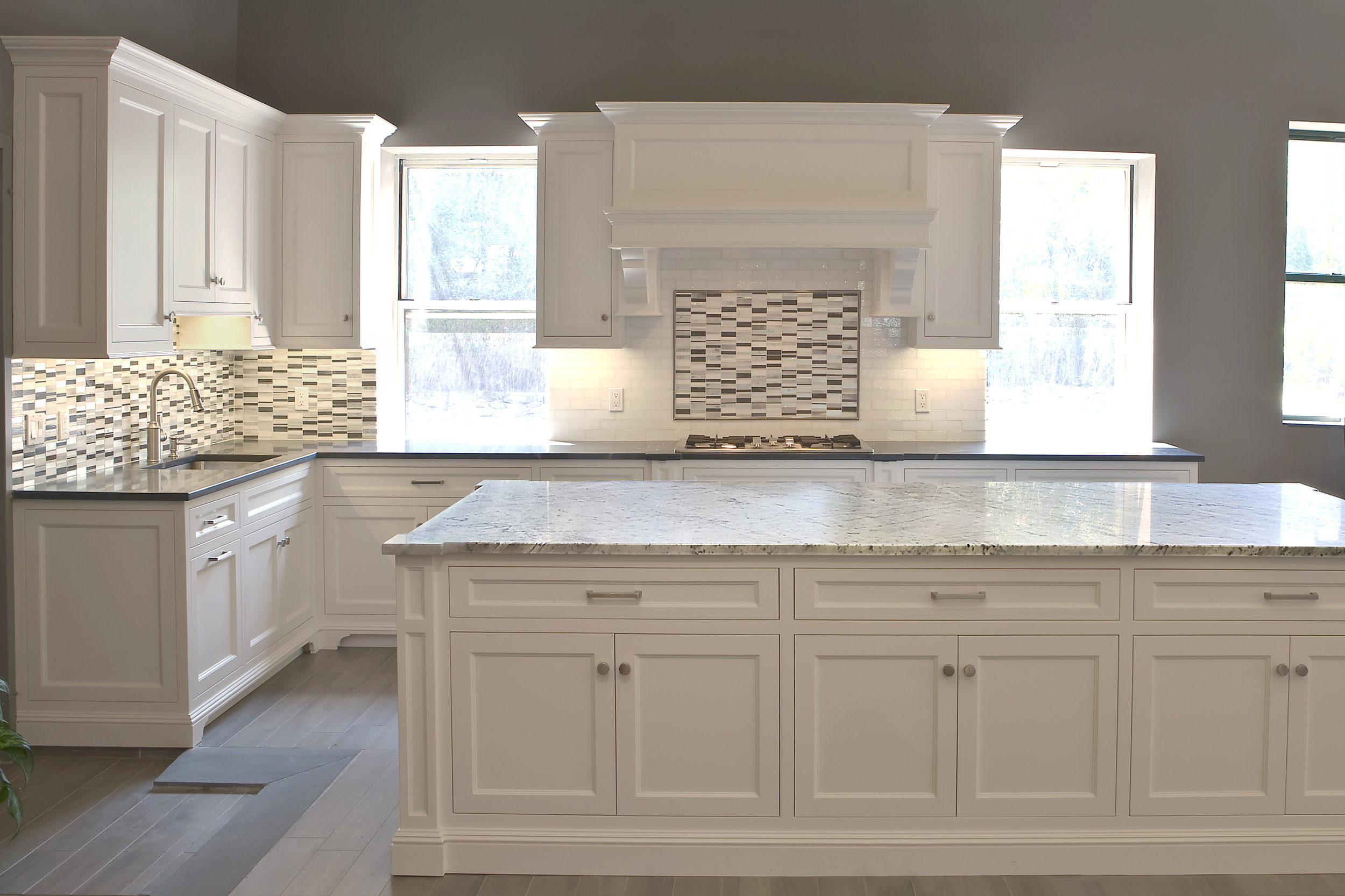 MATERIALS USED: CARERRA MARBLE ISLAND AND SOAPSTONE BACK COUNTER