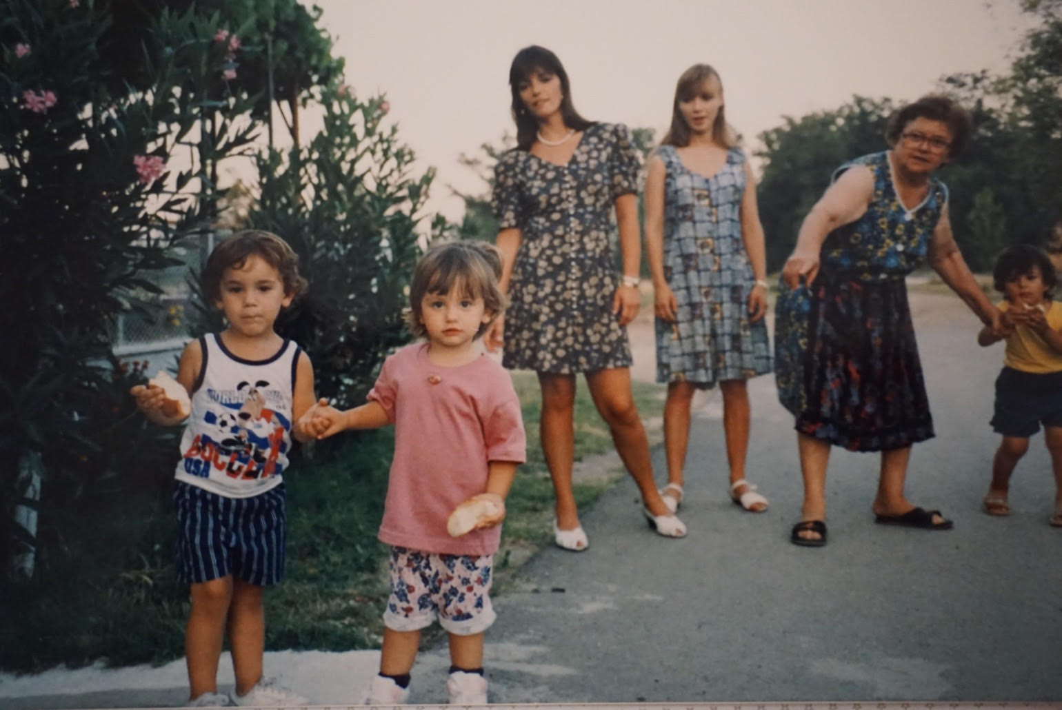 Foreground: Baby Anastasia & Alex eating bread Background: Mother, Aunt, Yiayia & cousin Location: Drosero, Greece