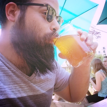 Me Untapping some brews when my beard was a little wild!