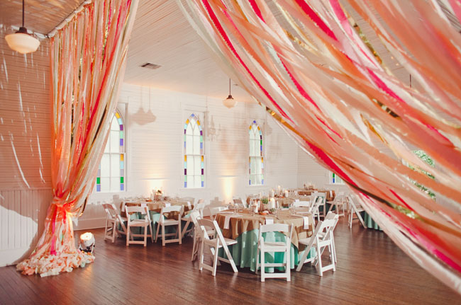 Reception Seating Inside w Coral Ribbons Draping.jpg