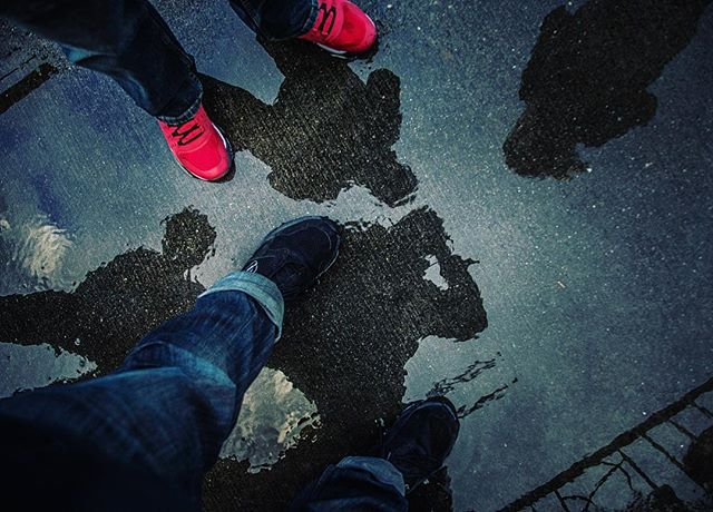 Adventure is always better as a shared experience. #seattle #street #rain #water #wet #sidewalk #sihlouette #lookdown #streetphotography #urban #concert #family #adventure #discover #explore #travel #seetheworld #travelling #washingtonstate #weather #storm #redshoes #mg5k  #moodygrams #mood #cold #happy #ajwilliamsphoto