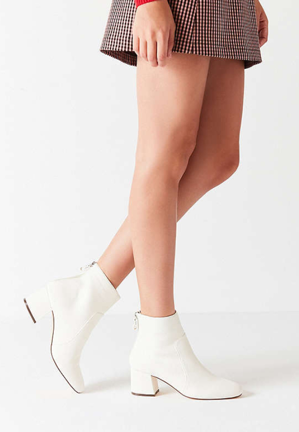 - These white boots are so fun and would look so cute with denim!