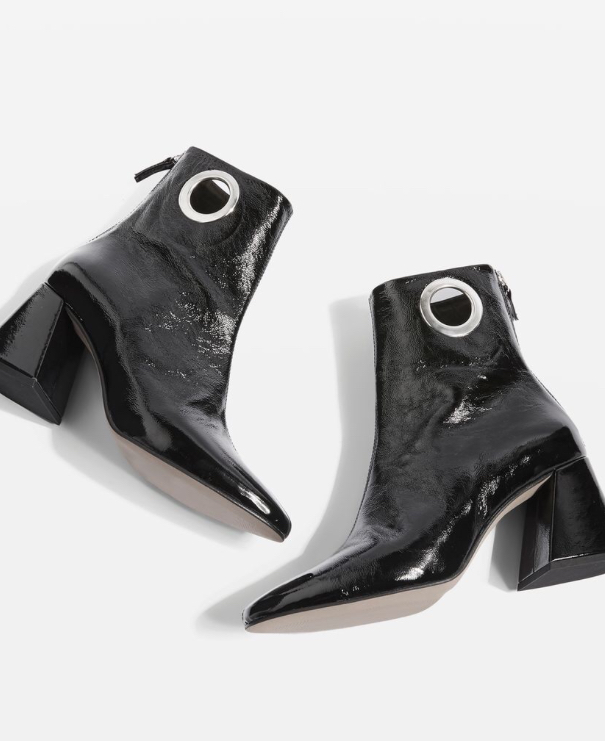 - These boots are so cool and I love the metal circle detail!