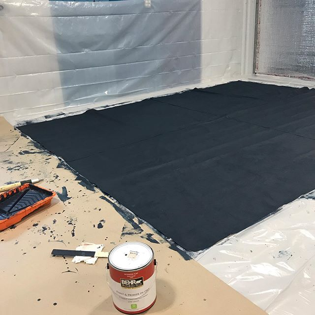 First stage of creating a DIY Oliphant style photography backdrop. This is a 9x12' canvas drop cloth painted with two coats of a dark dark blue flat paint. Already it has a beautiful texture and richness. Rolling on the base color was the easy part. Next is applying many layers of lighter and darker colors using different techniques. Very excited to see how this project this turns out.