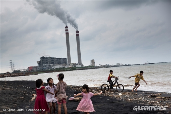 Children playing near a coal plant in Central Java