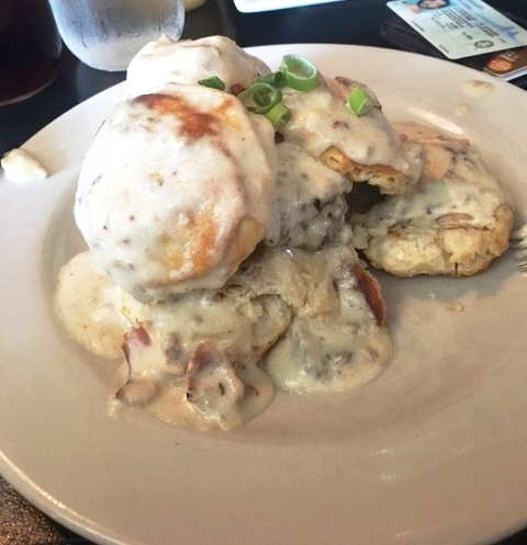 """Derek got the """"Biscuits and Groovy Burger"""" - it looks like a mess but it was SOO GOOD, I liked it more than what I ordered!"""