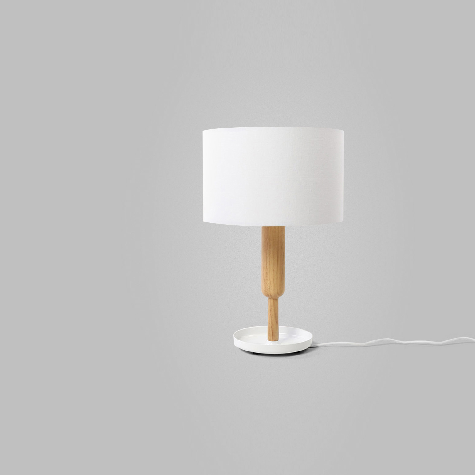 Fetch Lamp   Client: Fab 2014  The Fetch Lamp was the perfect combination of design and utility. An elegant accent, Clabots designed it to also serve as a neat storage space for small knickknacks. The unique, inverted shape of the lamp's base turned commonly-held design conventions on their heads while adding a touch of elegance.