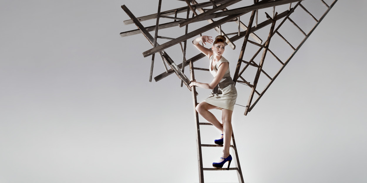 """Rise and Fall   Client Nisian Hughes for Getty Images 2011  Clabots collaborated with Photographer Nisian Hughes on his """"Rise and Fall"""" shoot for Getty Images. The series are conceptual business images using ladders to convey ideas of Discovery, Risk, Success, and the Way Forward. Clabots Designed and fabricated 6 custom sets with vintage painting ladders and developed a unique rigging system to suspend the models without disturbing their wardrobe. Images courtesy of Nisian Hughes, Getty Images.Clabots art directed this shoot along with Nonlinear Studio member Ron Beach."""