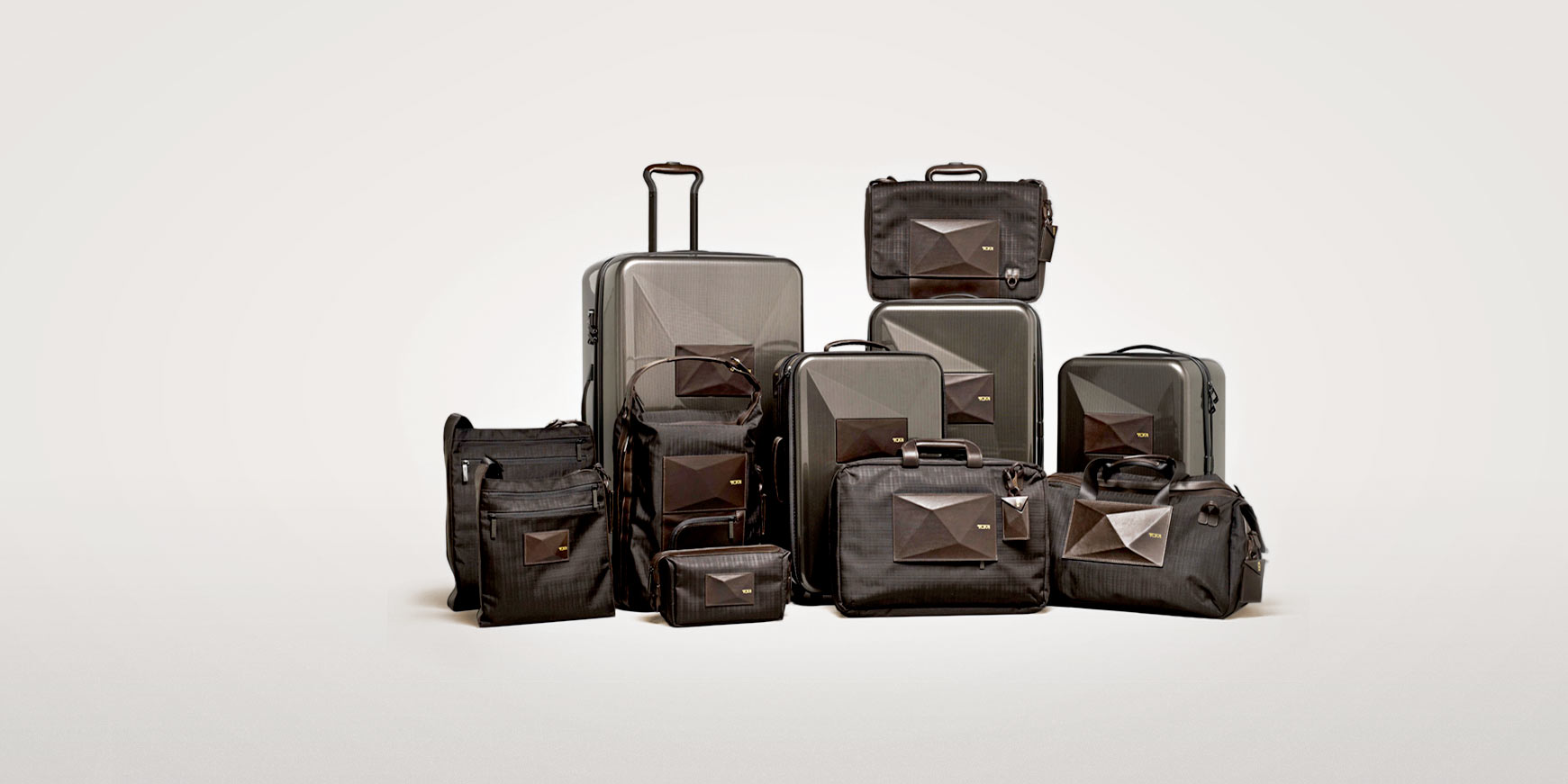 """Dror For Tumi   Client: Tumi (Work done at Dror.) 2012  The Dror for Tumi Collection featured luggage that transformed to meet the modern business traveler's ever-changing needs. The 11-piece collection included the first ever expandable hard-case carry-on for Tumi. Clabots' revolutionary """"living hinge"""" feature allowed one to adjust the bag's depth and nearly double its overall capacity.  Award:  Red Dot Award for Product Design 2013 ( International Expandable Carry-On )   Award:  Travel & Leisure's 2013 Design Awards ( Tote / Backpack )"""