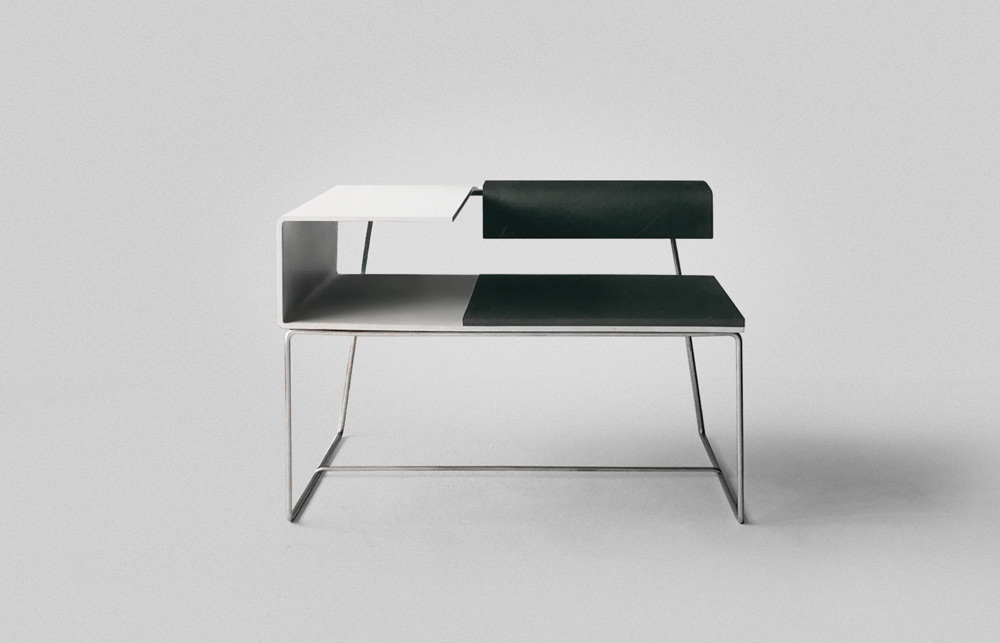 School Desk   Concept: TAIK 2003  The reimagined school desk rethought how we sit for long periods of time. The lower back support provided lumbar support when sitting upright, or it offered an elbow rest for leaning back. Storage for a bag was located under the writing surface. Clabots developed this while studying abroad in Finland, utilizing the advanced technical knowledge of the country's wood-bending industry to mold this piece as one bent lamination form.
