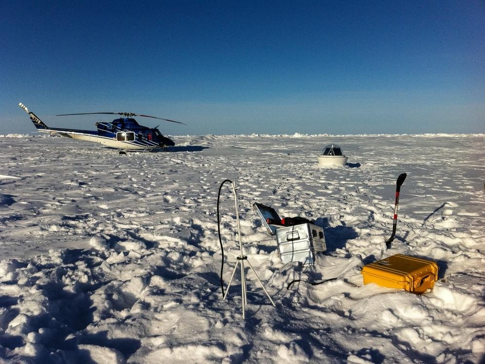 Ice Mass Balance Buoy (foreground) and Wave Buoy (background).
