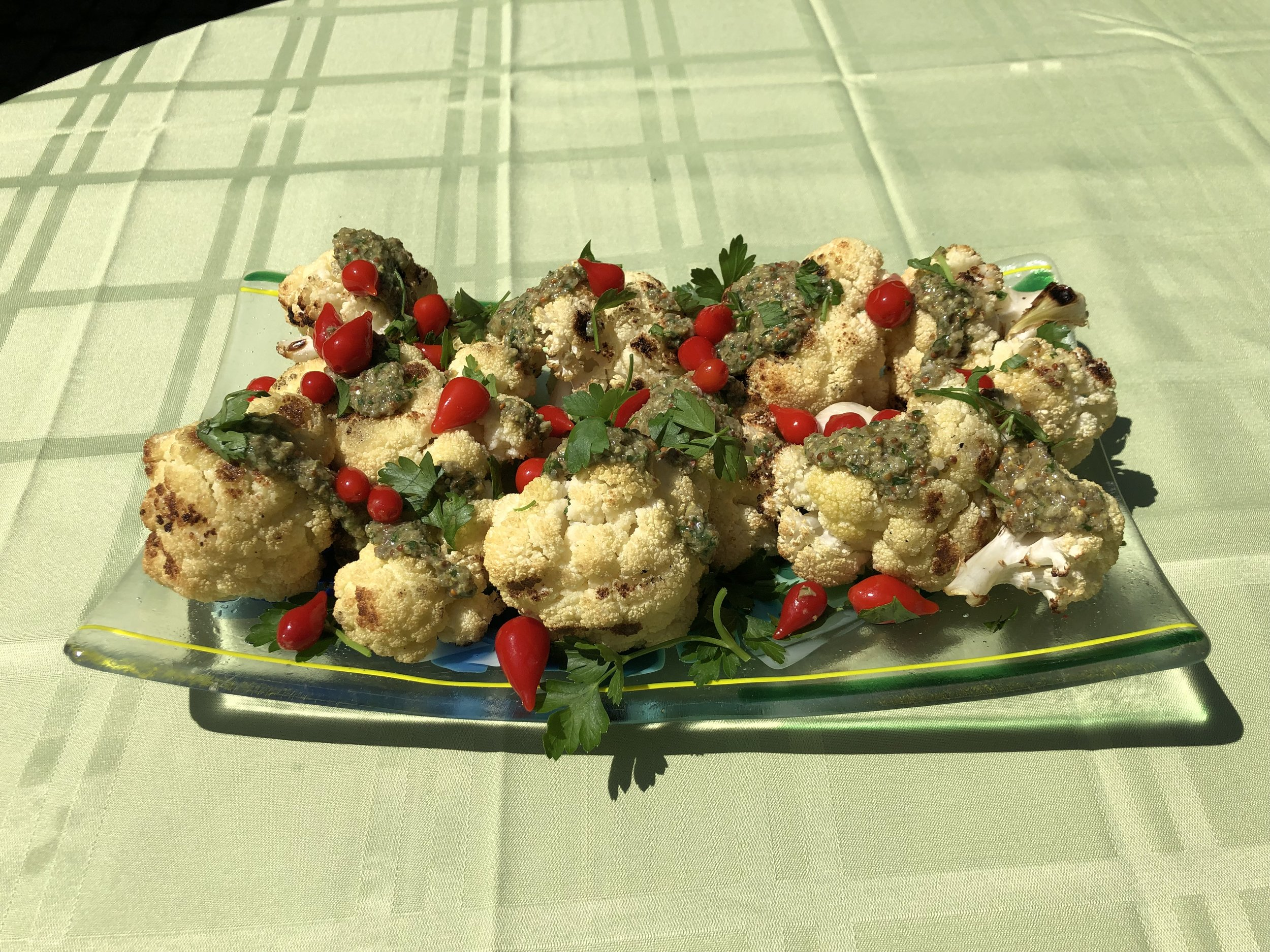 grilled cauliflower with mustard, capers, and peppers