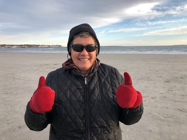 Brenda thumbs up on a cold beach.jpg