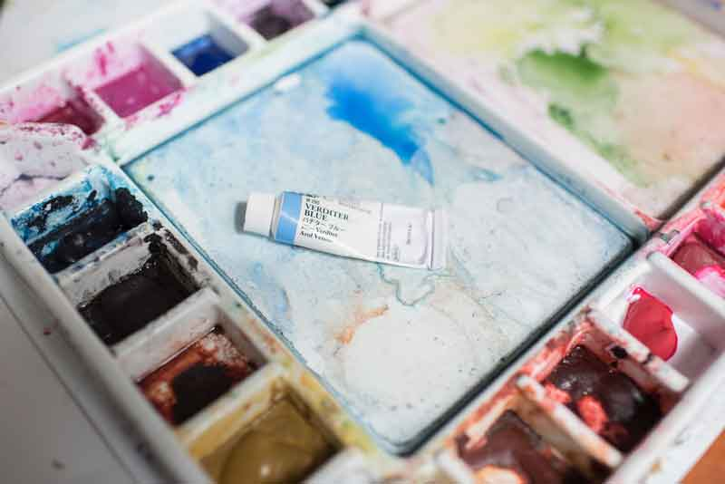 A tube of Verditier Blue watercolor paint, one of my favorite colors.