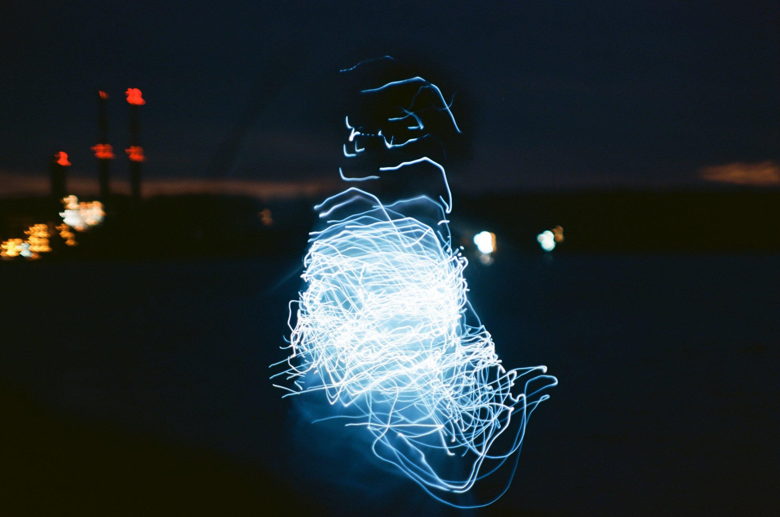 Woman_twirls_with_lights.jpg