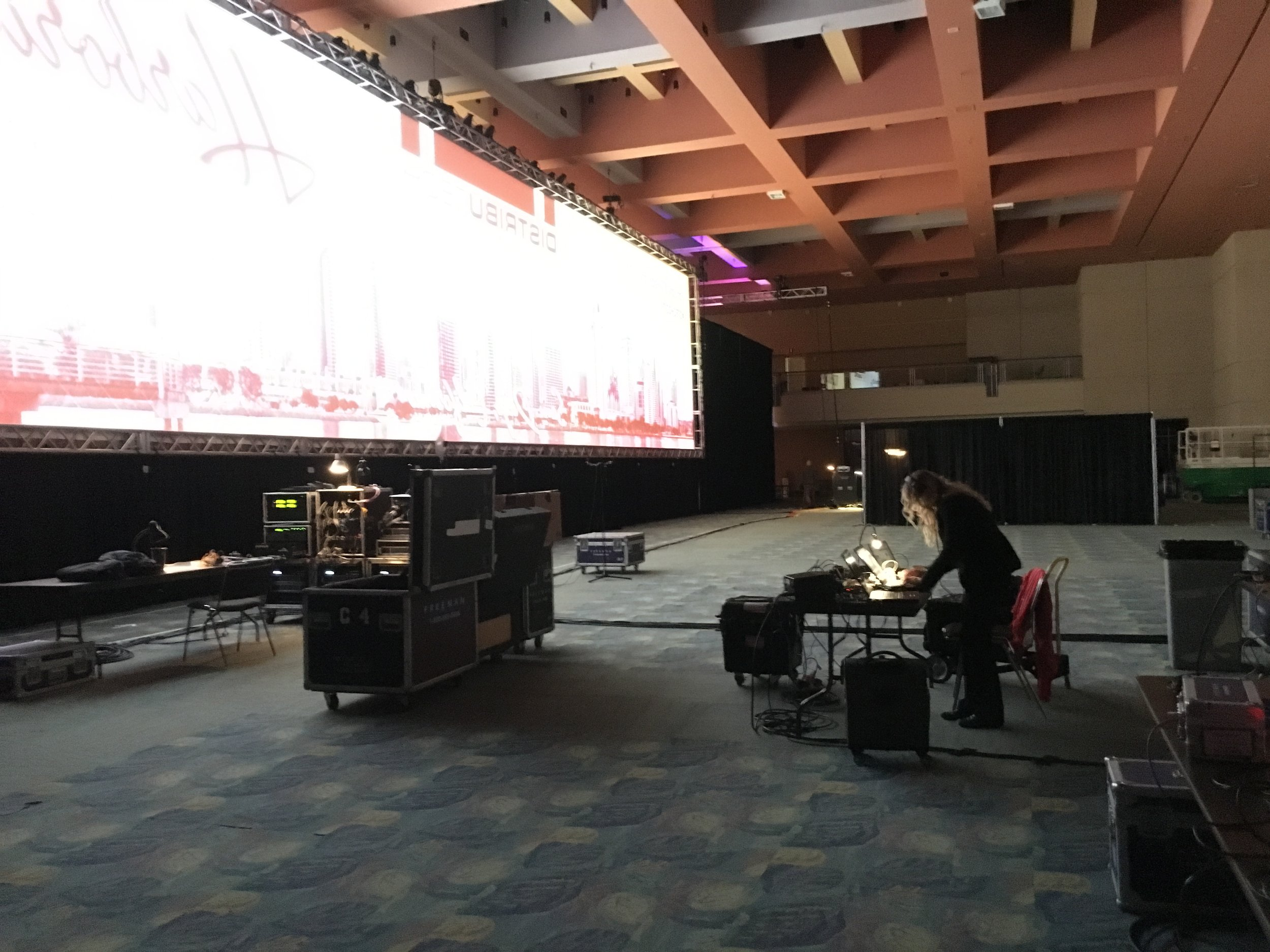 A peek backstage, wow that screen is huge!  We share backstage space with Freeman, a highly respected company in the event industry.  They are providing all AV/Production services for our clients and are great to work with.