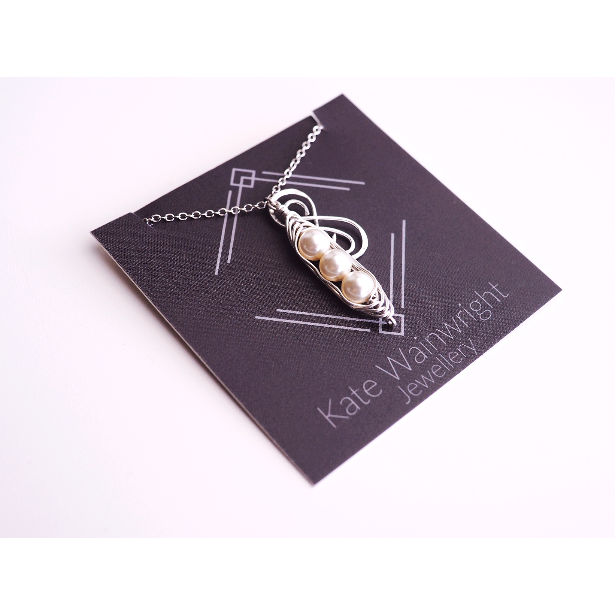 Kate Wainwright Jewellery | Silver and Pearl Pea Pod Necklace with Infinity Charm | Friendship Necklace
