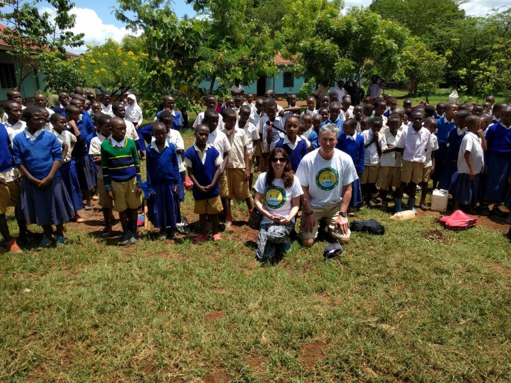 Paul & Jess Jameson with pupils from Miwaleni Primary School in Tanzania v1.jpg