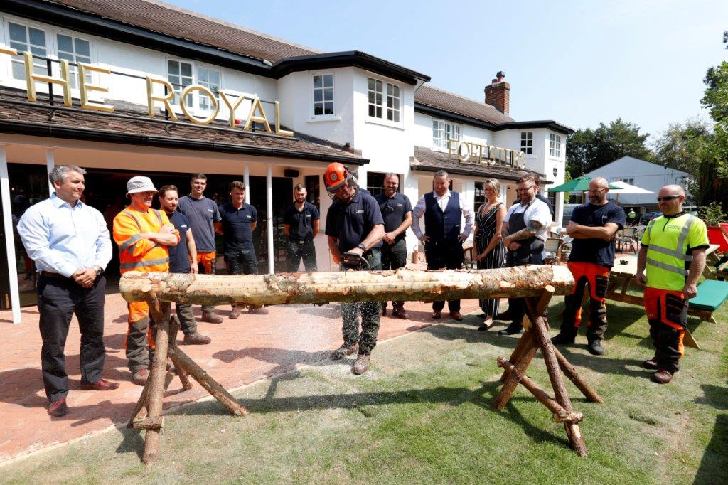 Russell Sturgess, longest serving forester sawing the 'ribbon' at Royal Foresters (Ascot) re-opening ceremony.jpg
