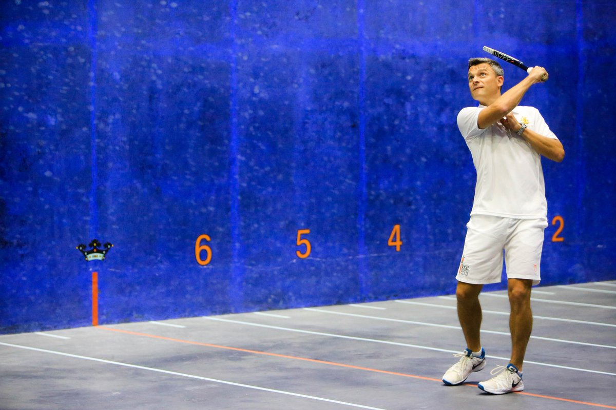 Head Pro Dan Jones serving on the new Real Tennis court at  Wellington College