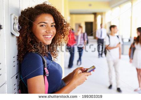 stock-photo-female-high-school-student-by-lockers-using-mobile-phone-199303319.jpg