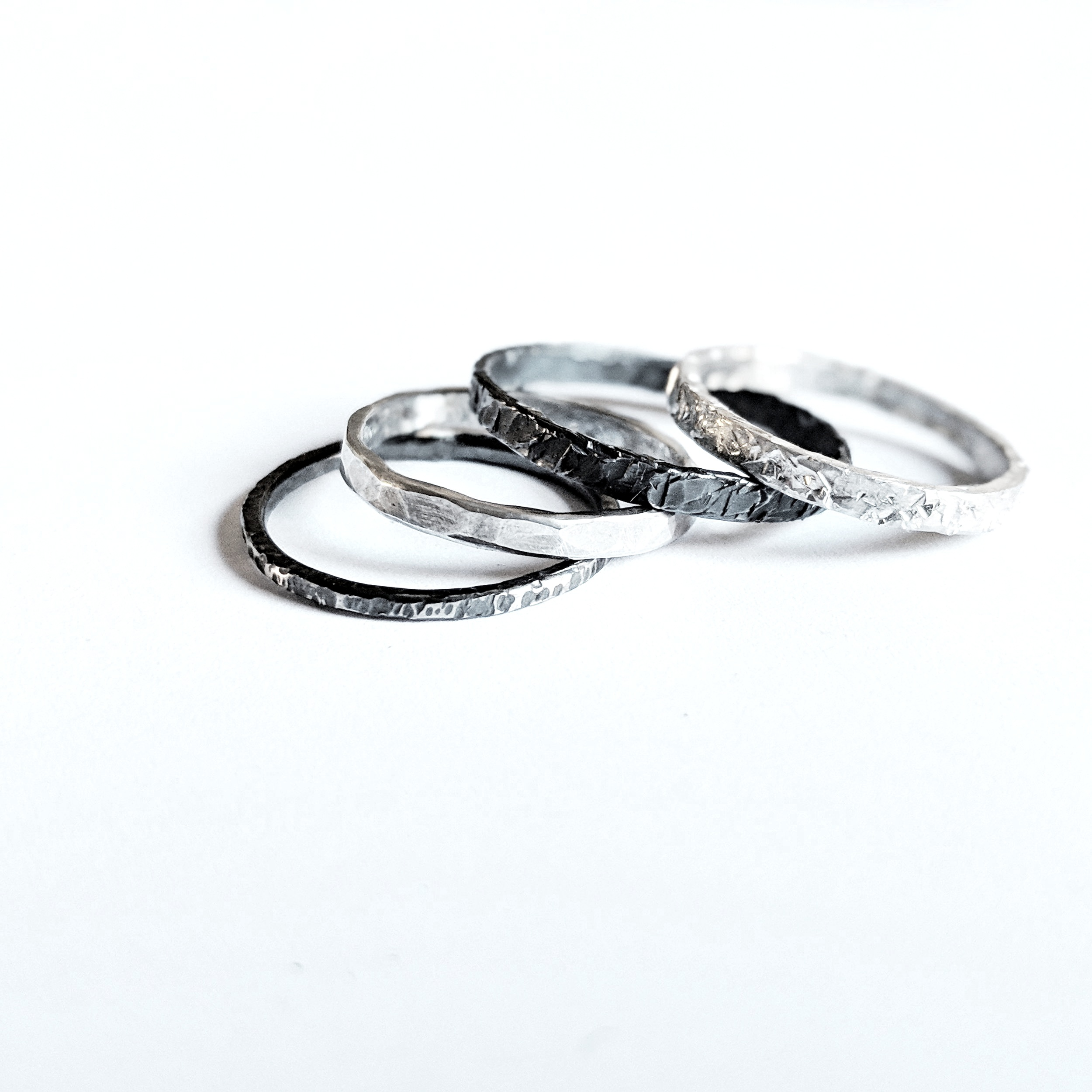 kirsten+manzi+jewellery+-+textured+silver+and+oxisised+stack+rings+.jpg
