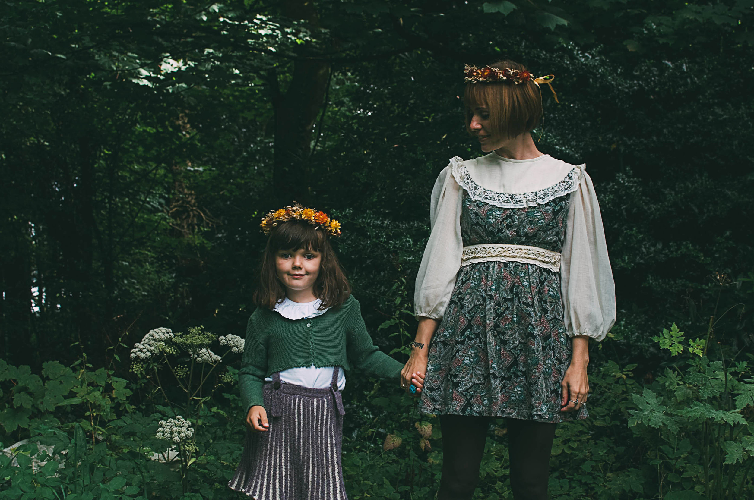 Lulu with her cherub Immy, wearing flowers crowns from Botanical Tales