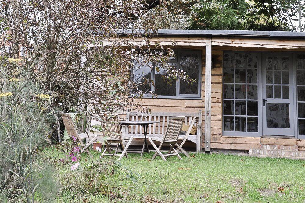 Wood Cabin in a wildflower meadow