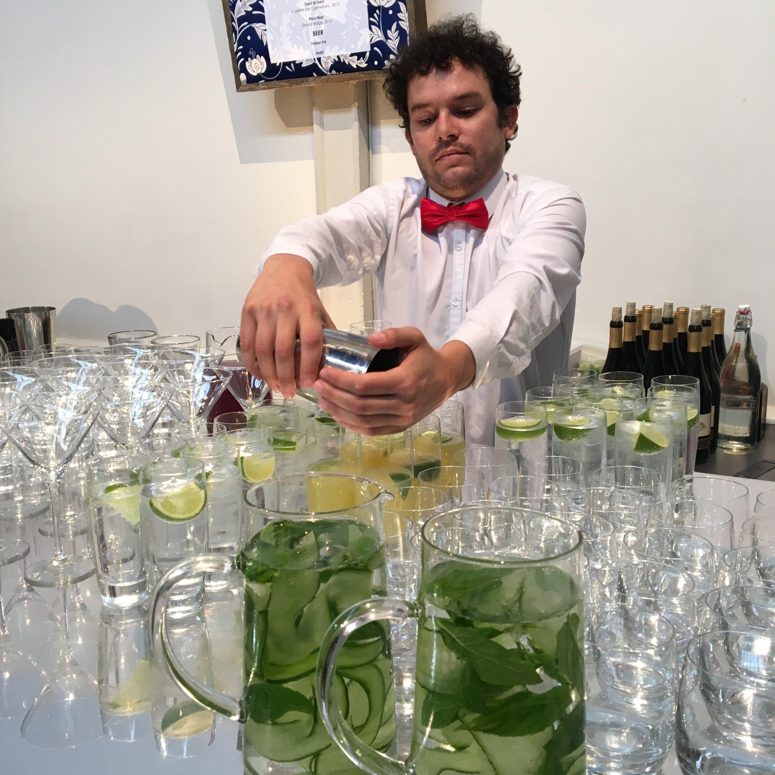 Bartender Remi prepping for a wedding reception