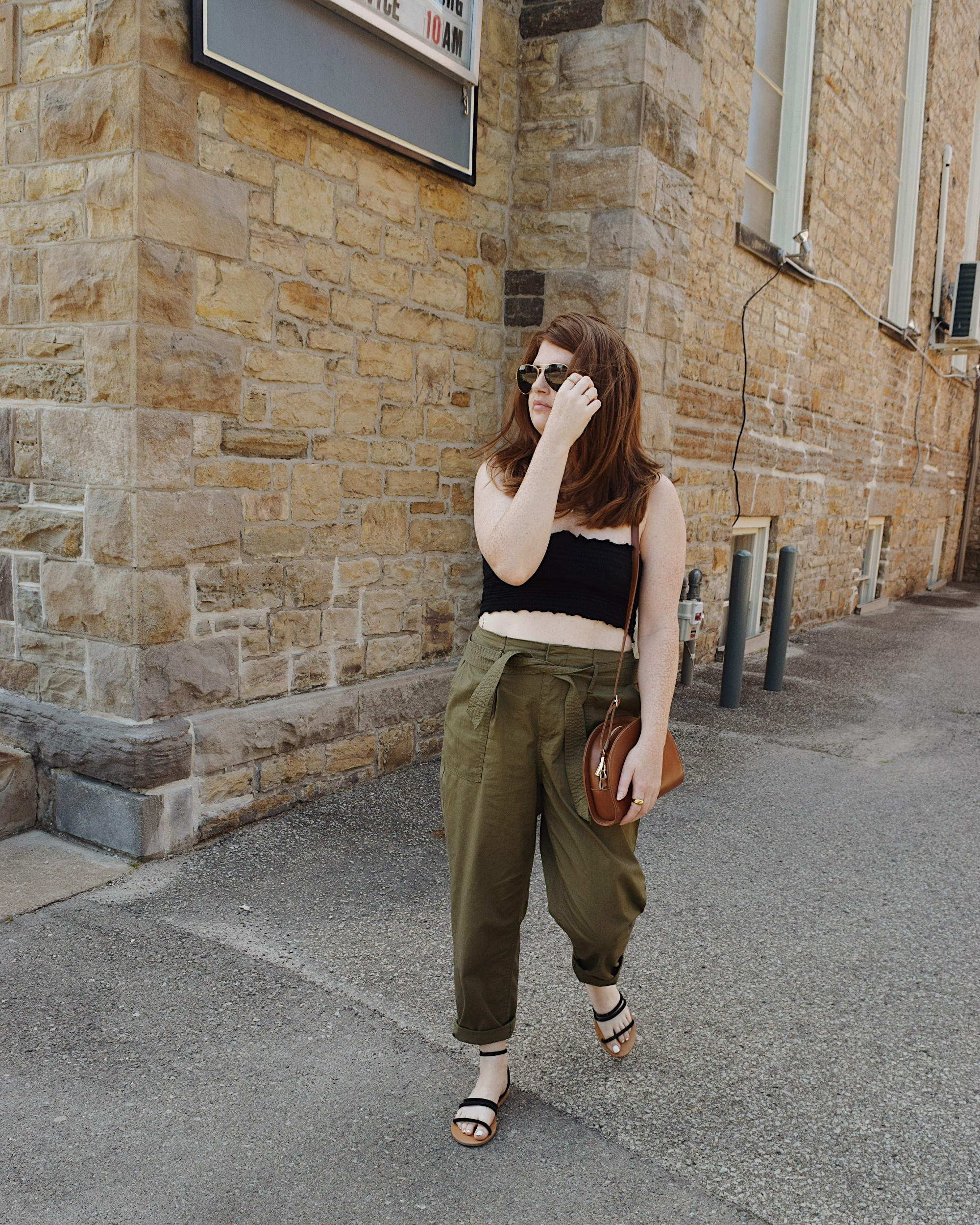 Wearing green high waisted pants from New York and company